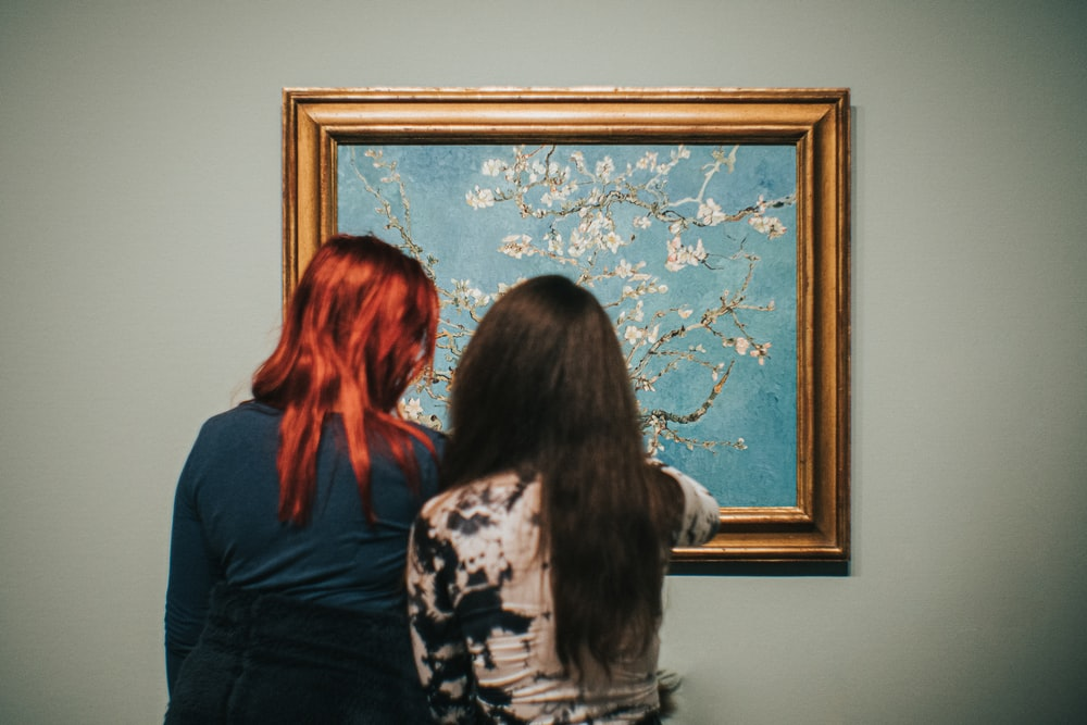two women standing near Almond Blossom painting by Vincent Van Gogh