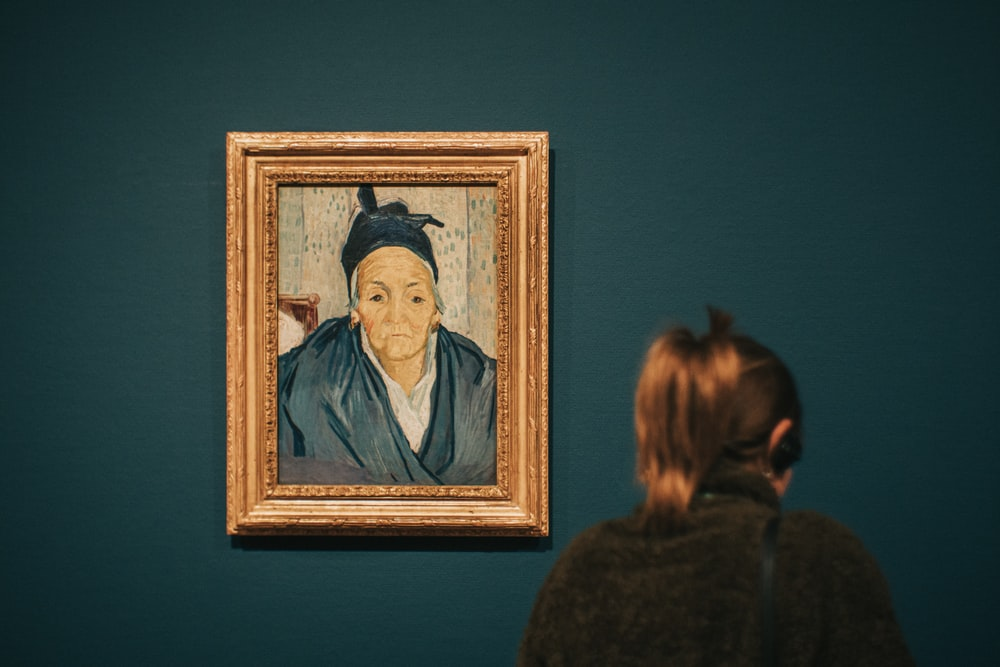 person standing near Old Women of Arles painting by Gauguin
