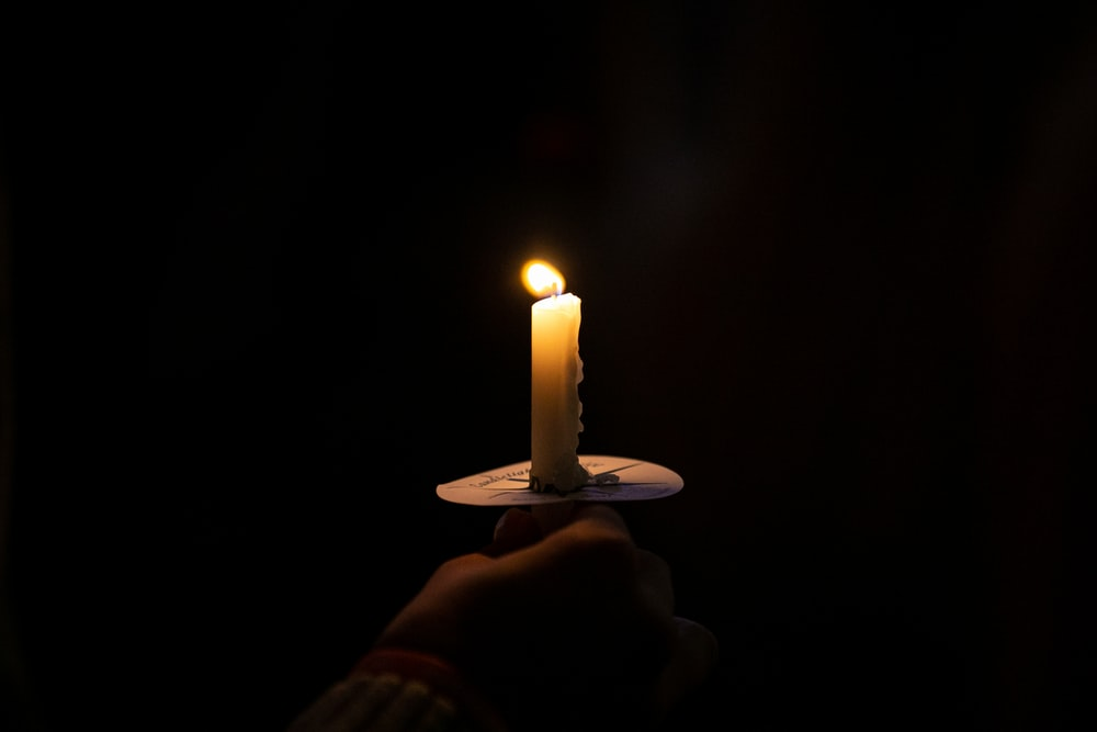 lighted taper candle