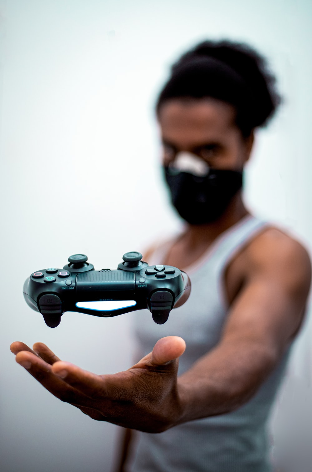 man tossing game controller. Representative of gaming and esports across the world