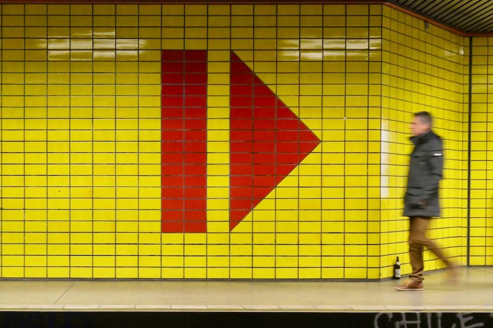 man walking inside subway station
