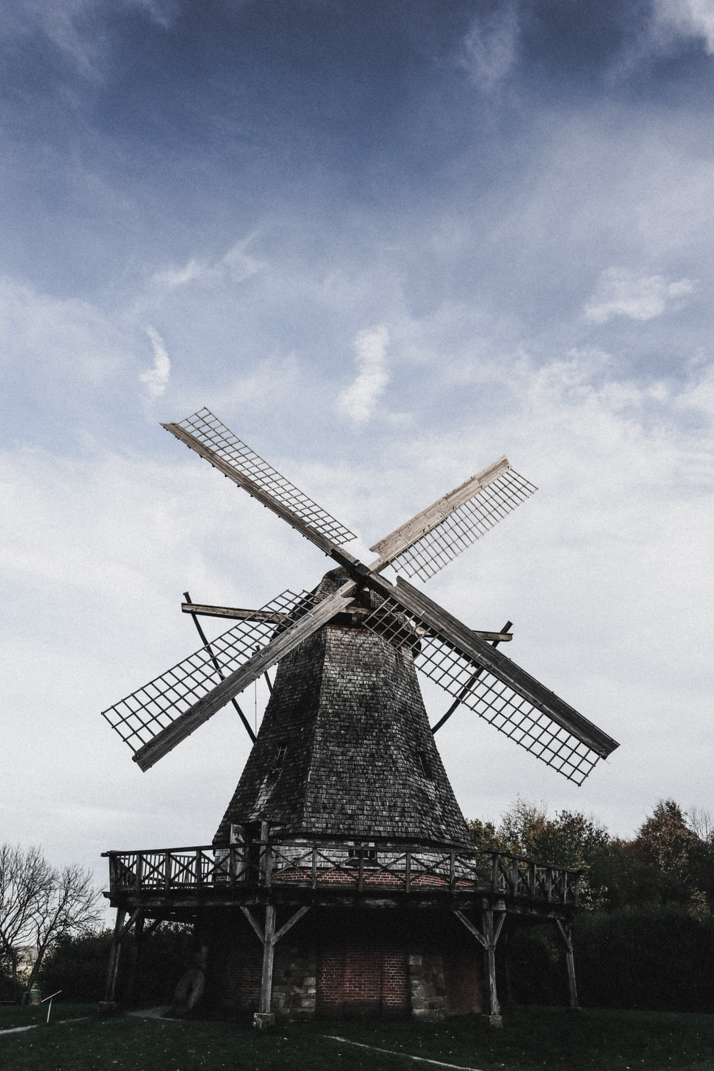 windmill under blue and white sky