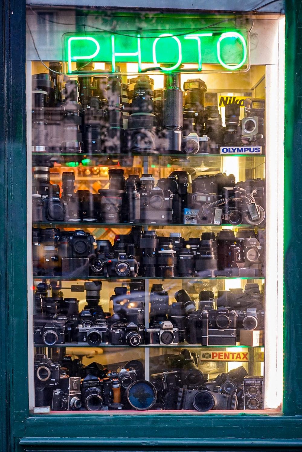 vintage cameras in display cabinet