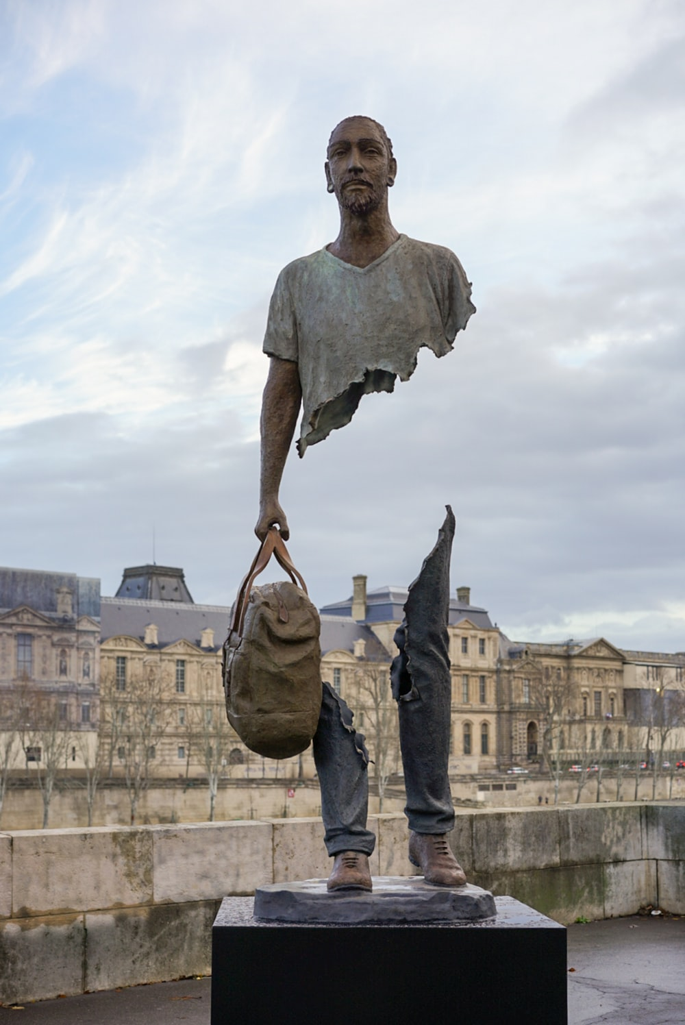 standing man with bag statue
