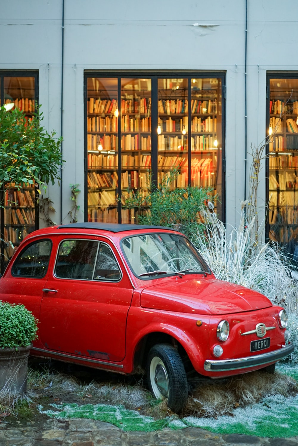 red FIAT 500 outside building