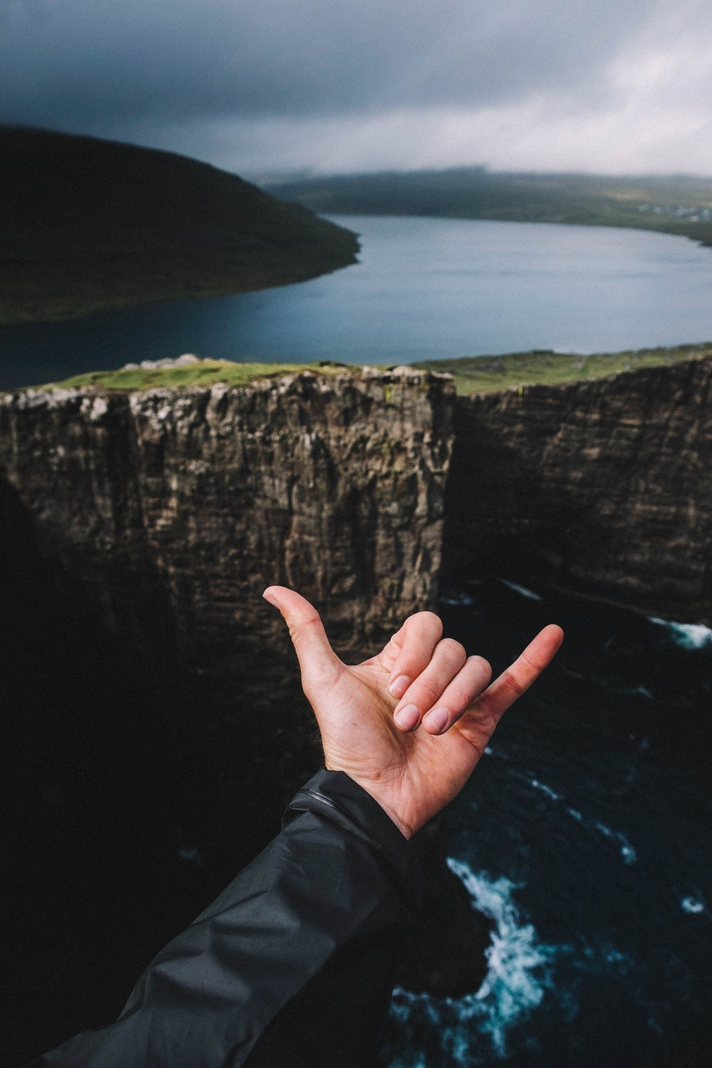 person doing hand sign photograph