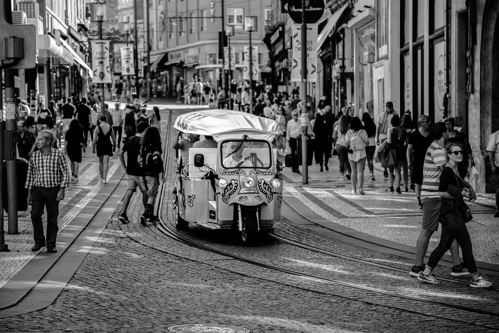 grayscale photo of autorickshaw on road