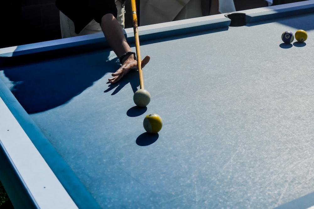 person playing billiard