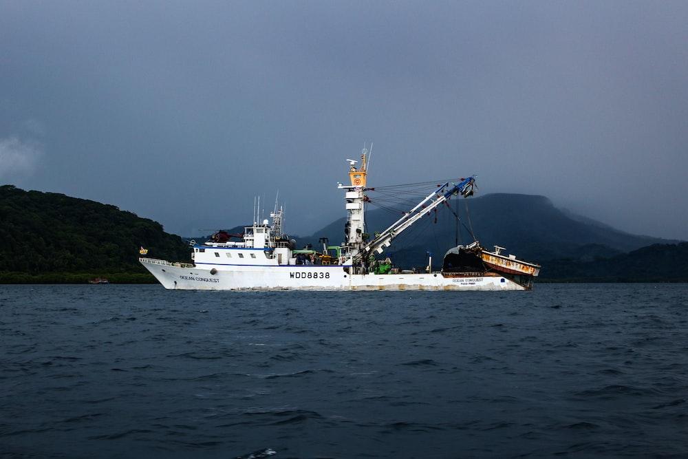 sailing white fishing boat
