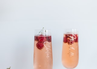 two full clear glass bottles