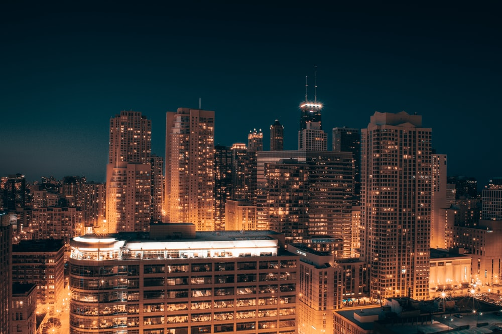 city with high-rise buildings during night time