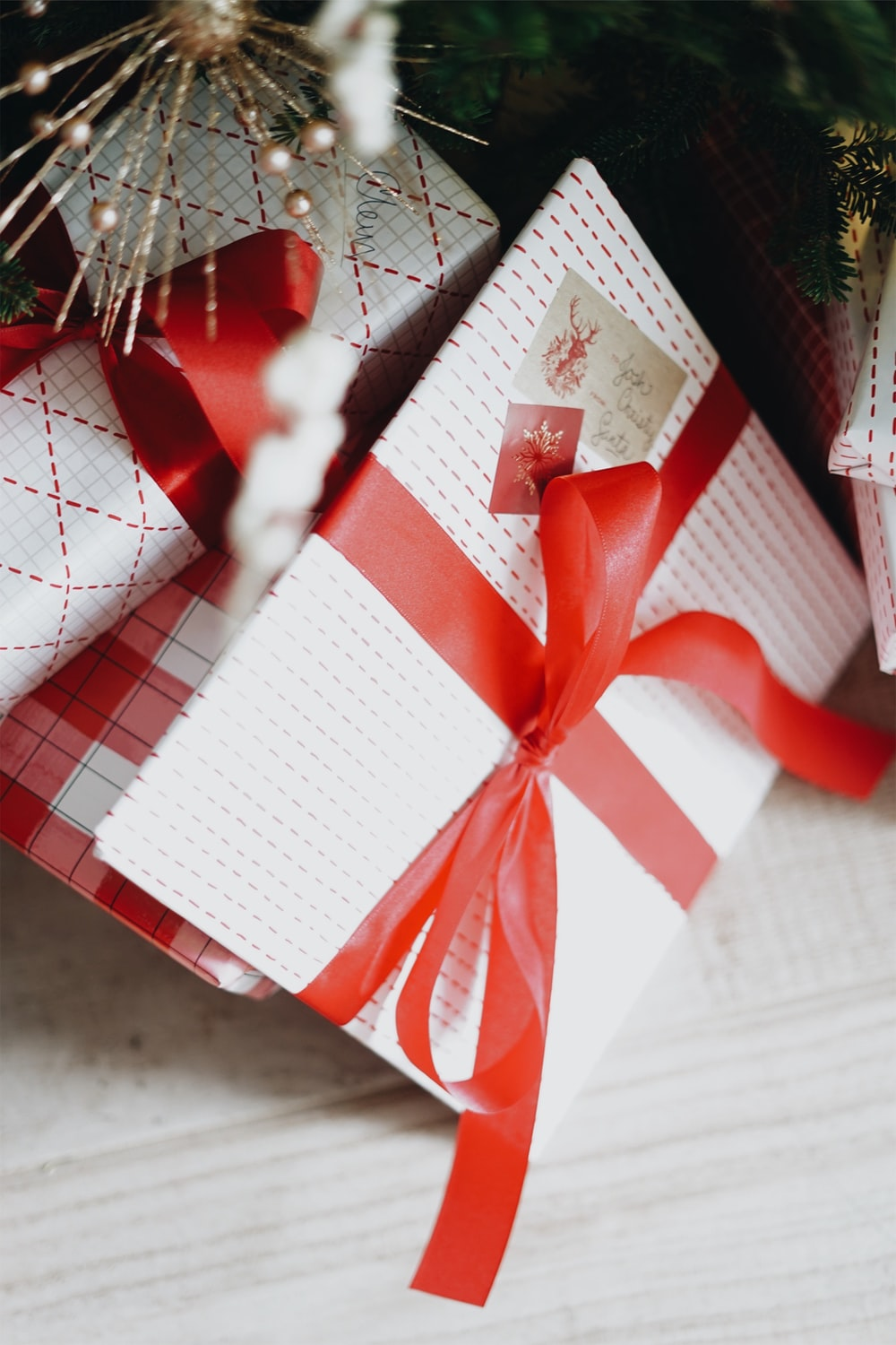 selective focus photography of white and red gift boxes