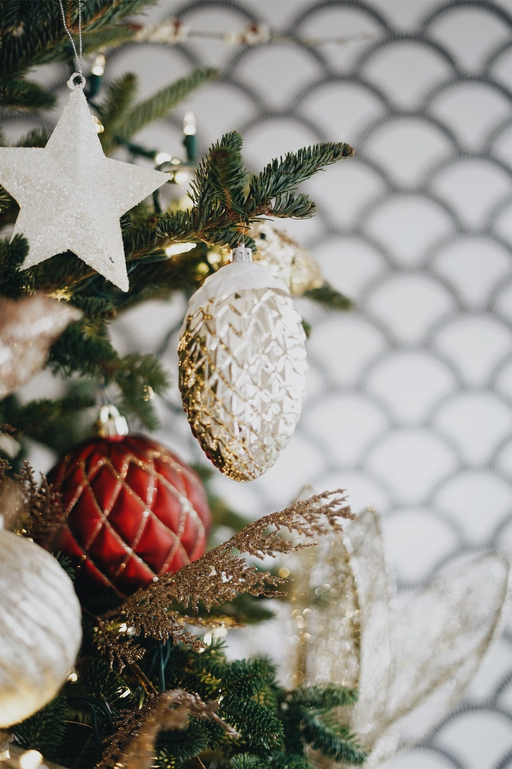 selective focus photography of ornaments on Christmas tree