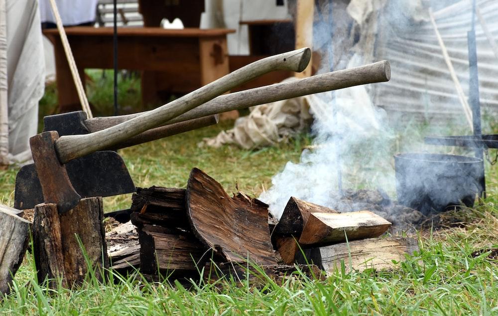 gray ax on firewoods