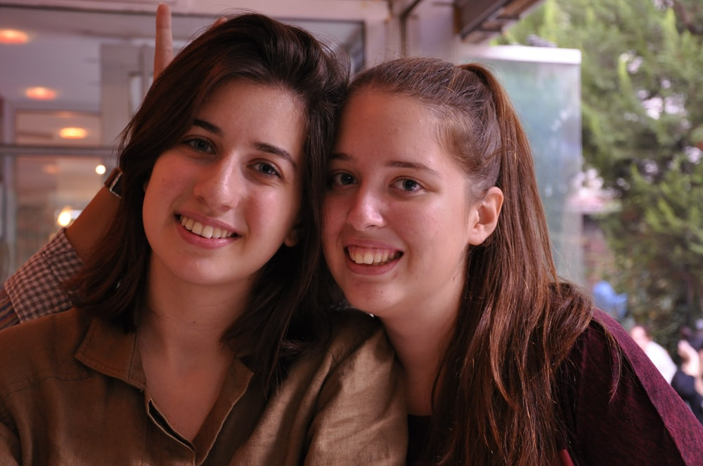 smiling female twins