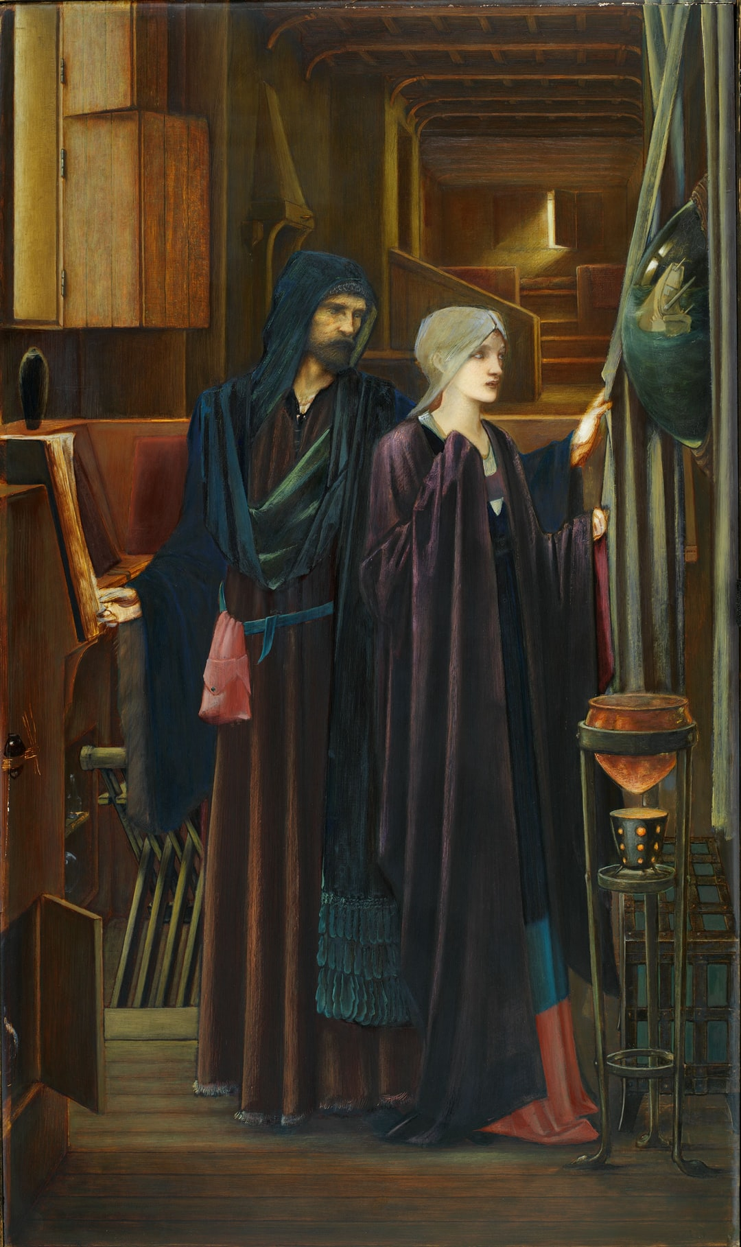 The Wizard, 1898. Two figures in a narrow, darkened chamber. A bearded man in a heavy robes, reveals a convex mirror to a young, veiled girl, behind a drape. Artist: Edward Burne-Jones