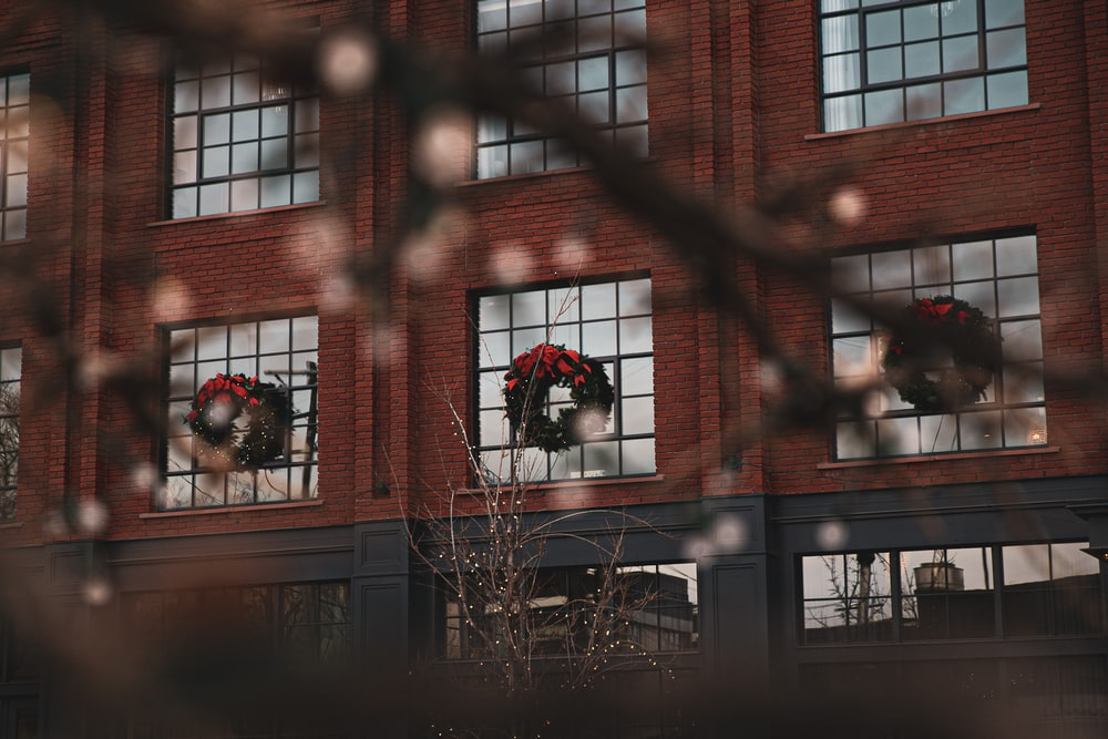 building with wreaths on windows