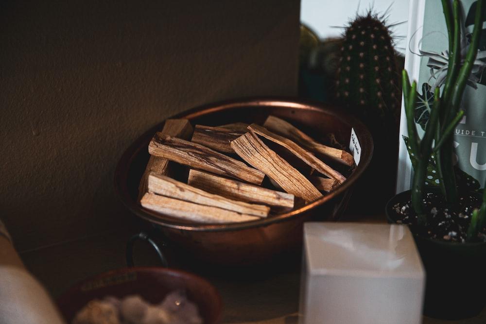 brown sticks in bowl