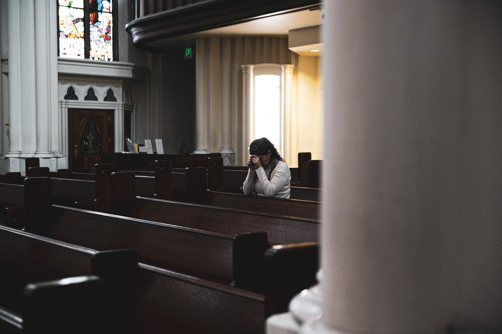 woman praying in cathedral