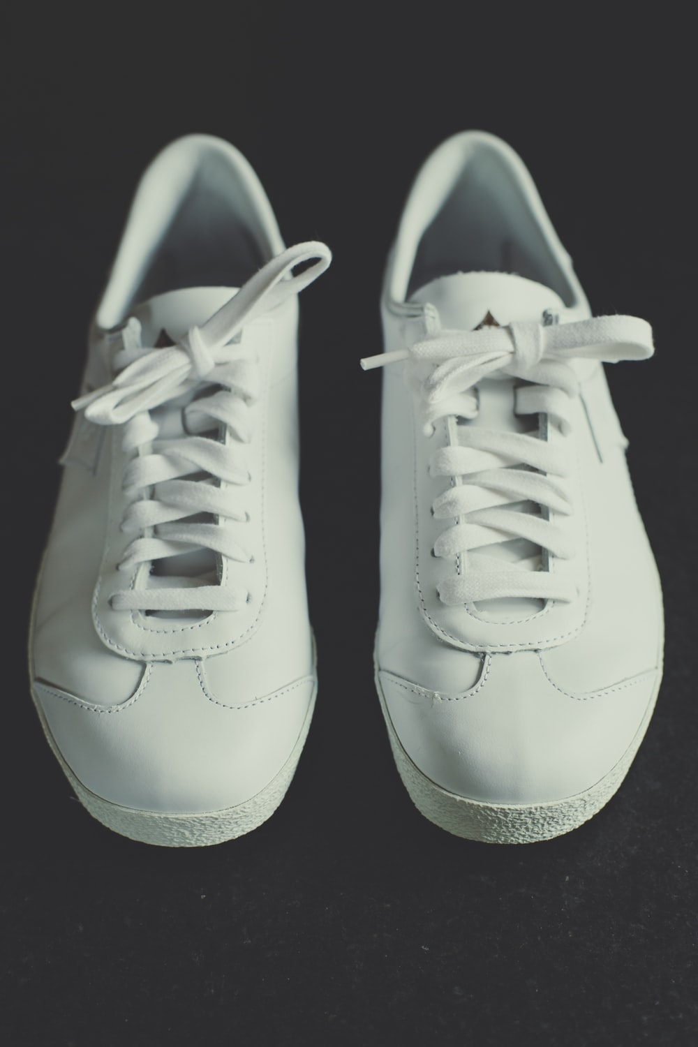 pair of white low-top shoes
