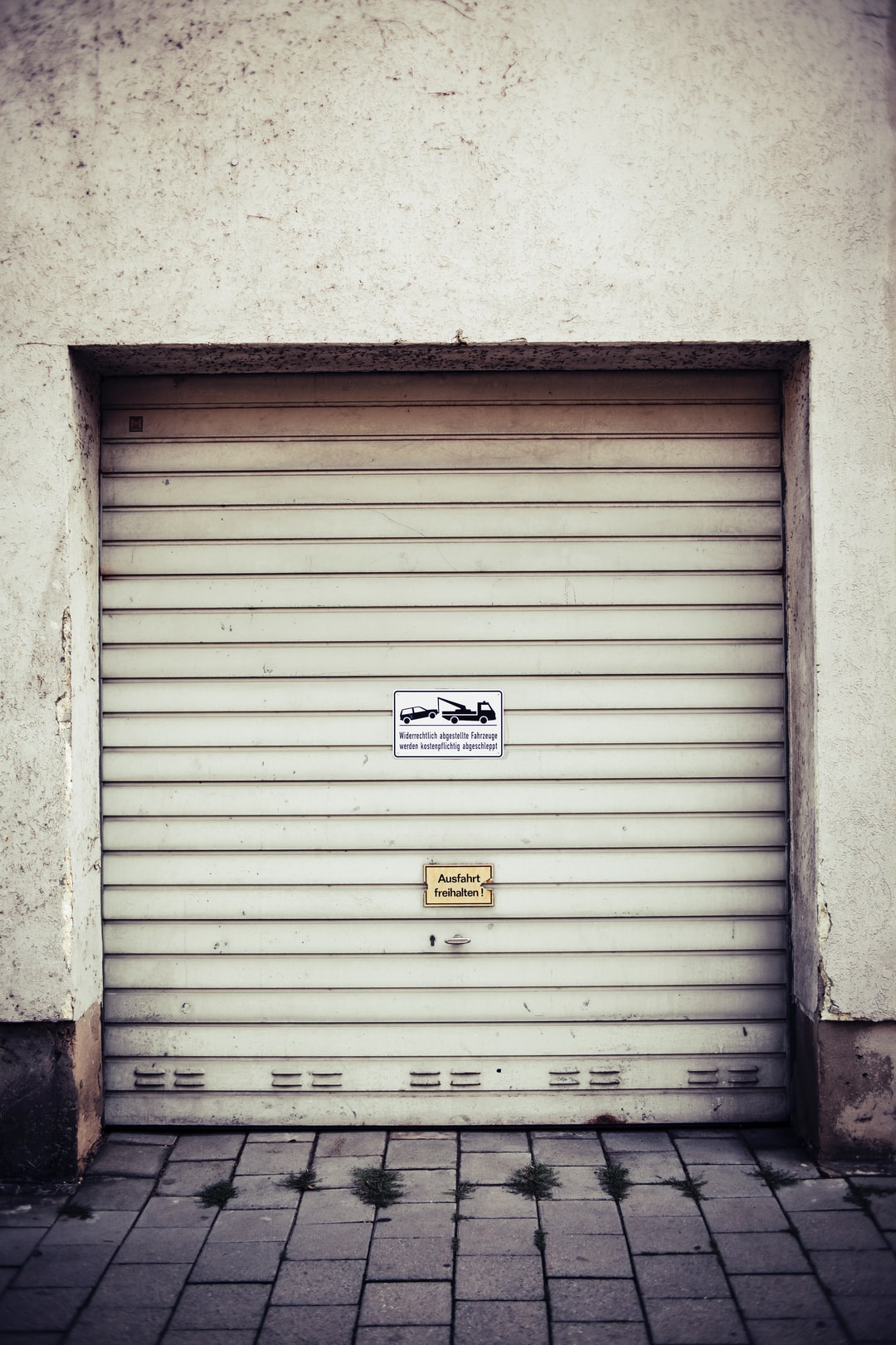 Cloesed garage sliding gate. Made with Canon 5d Mark III and vintage analog lens Leica Summicron-R 2.0 50mm.
