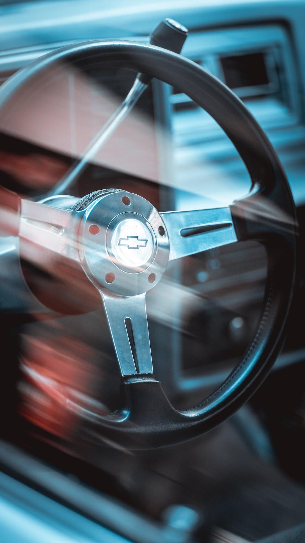 shallow focus photo of gray Chevrolet steering wheel
