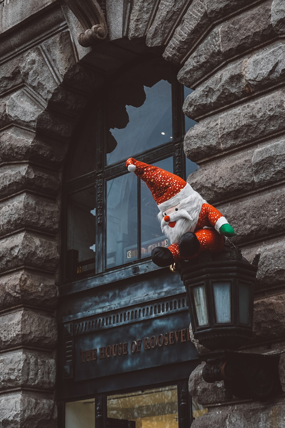 santa claus plush toy on wall sconce