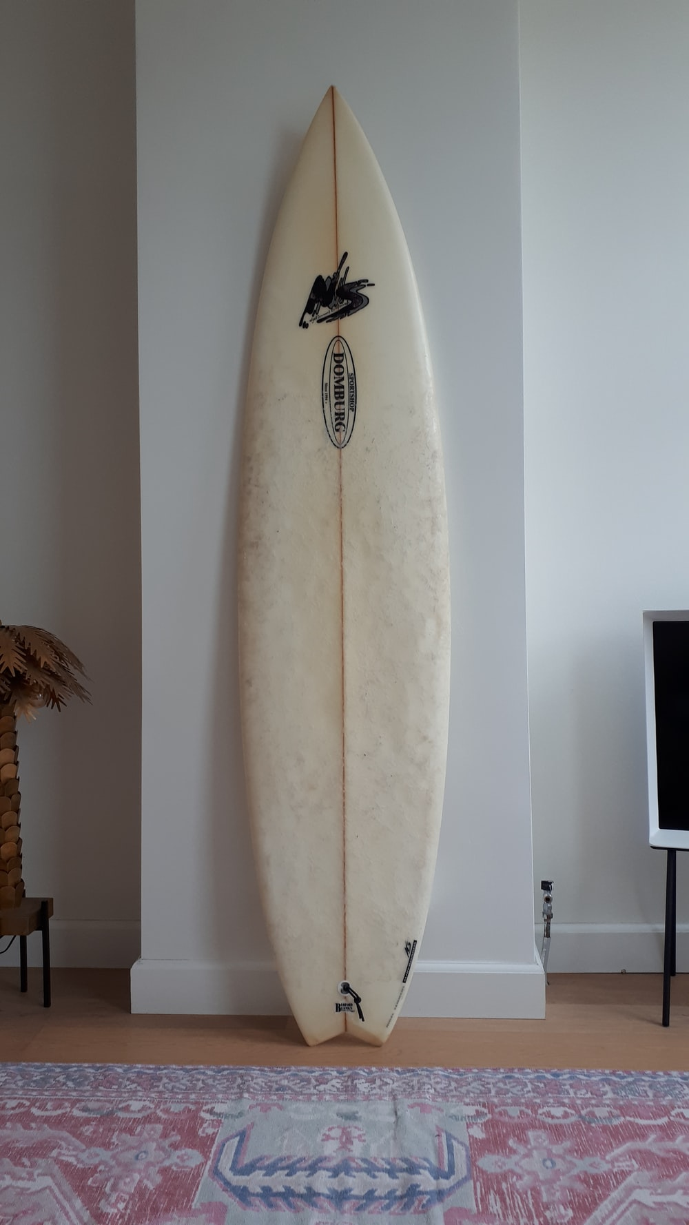 white surfing board on wall