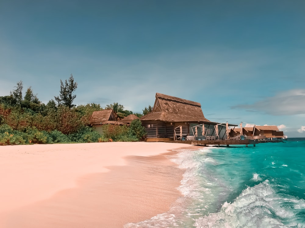 beach resort with wooden cottage during daytime