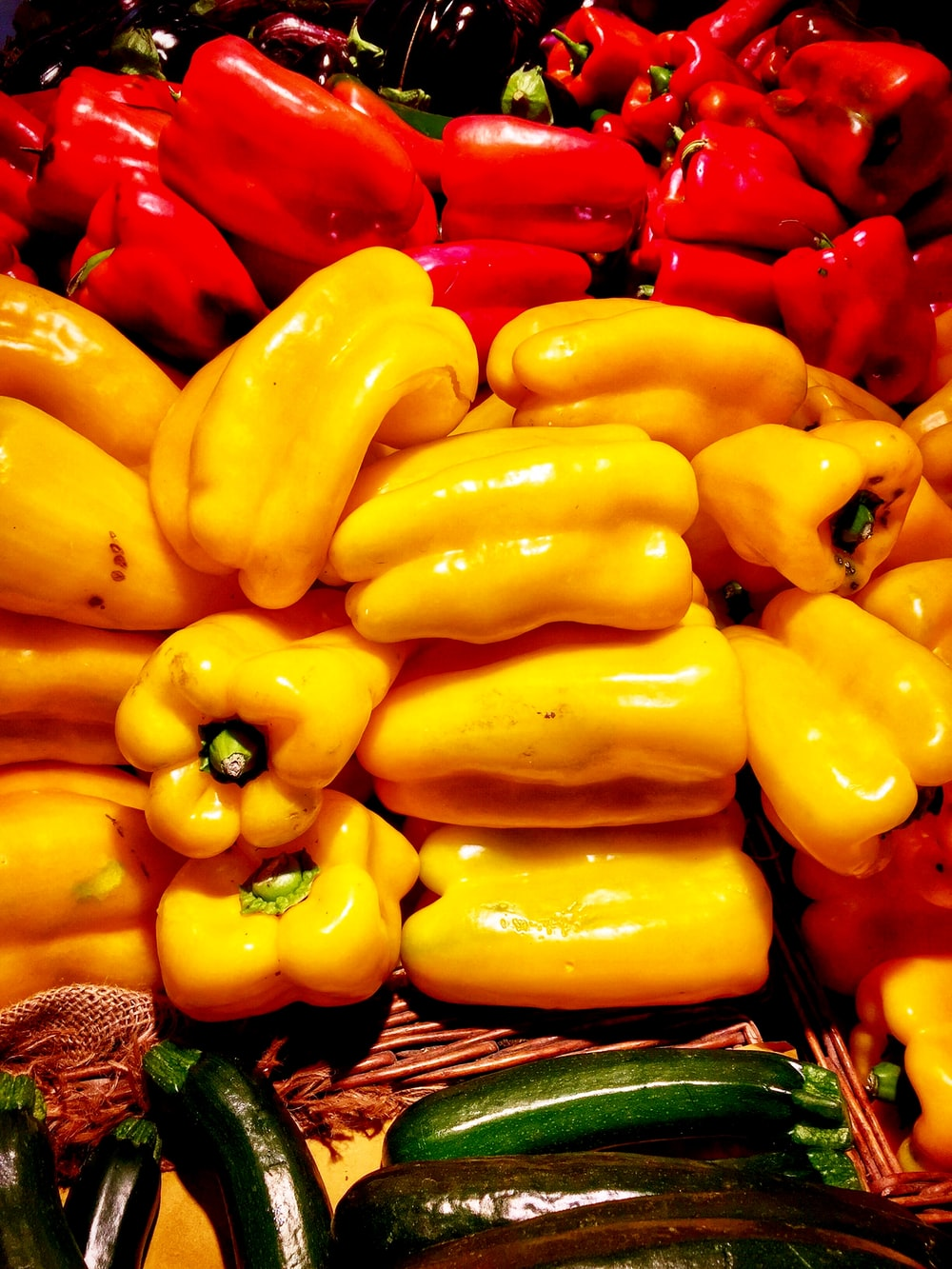 pile of yellow and red bell peppers