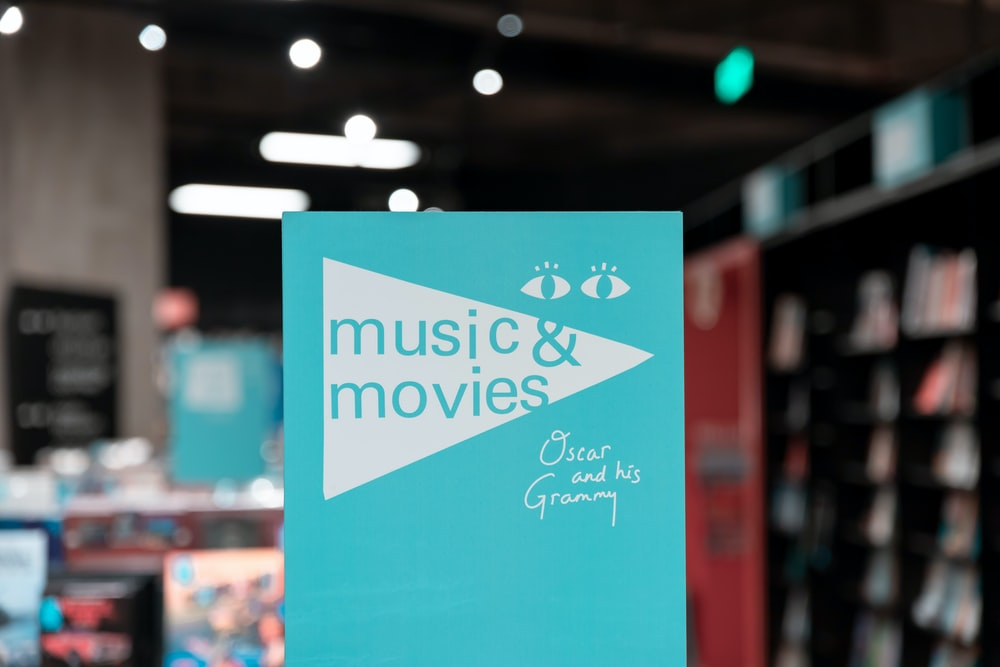 selective focus photography of Music & Movies card
