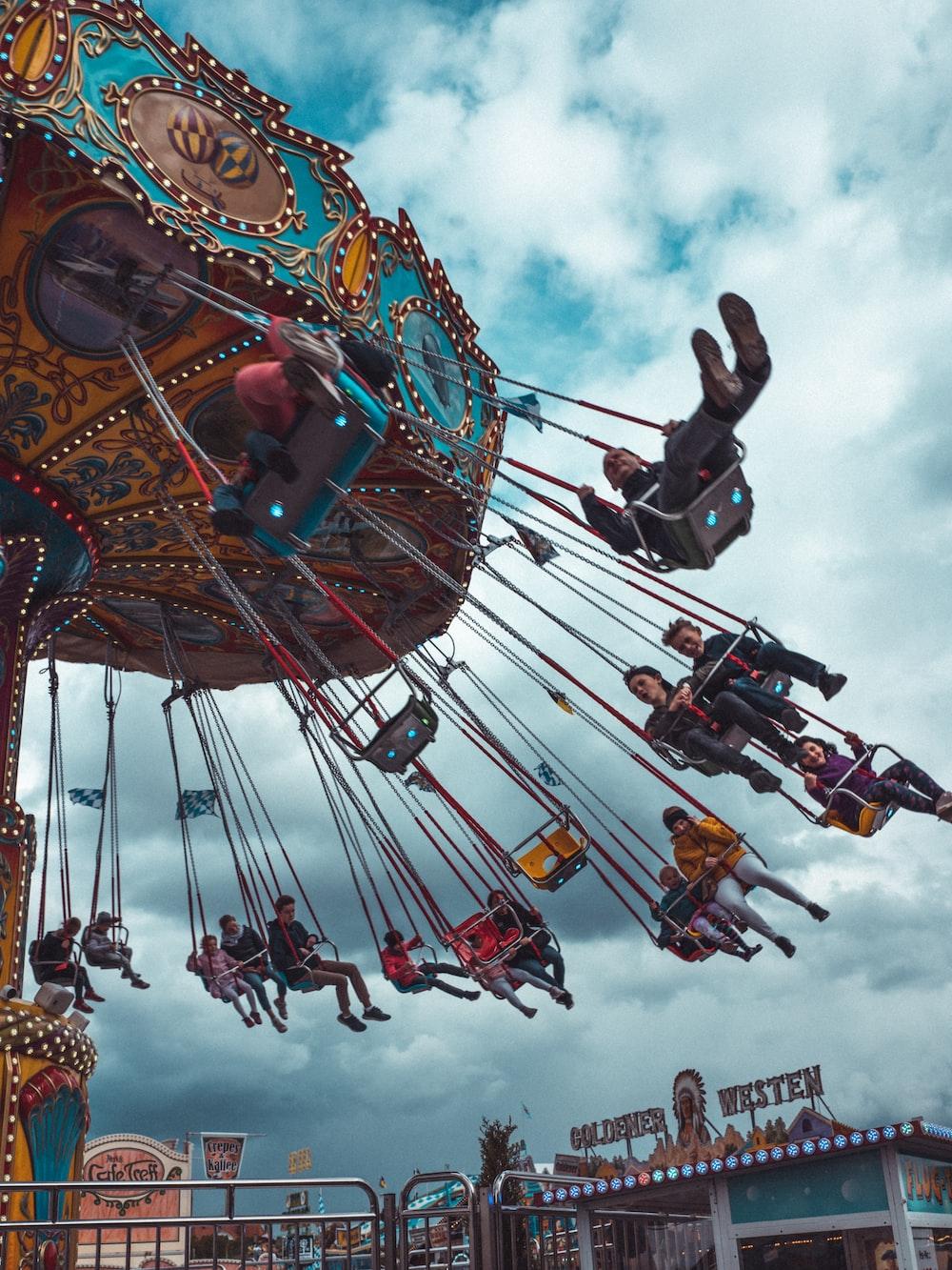 people riding swing amusement ride