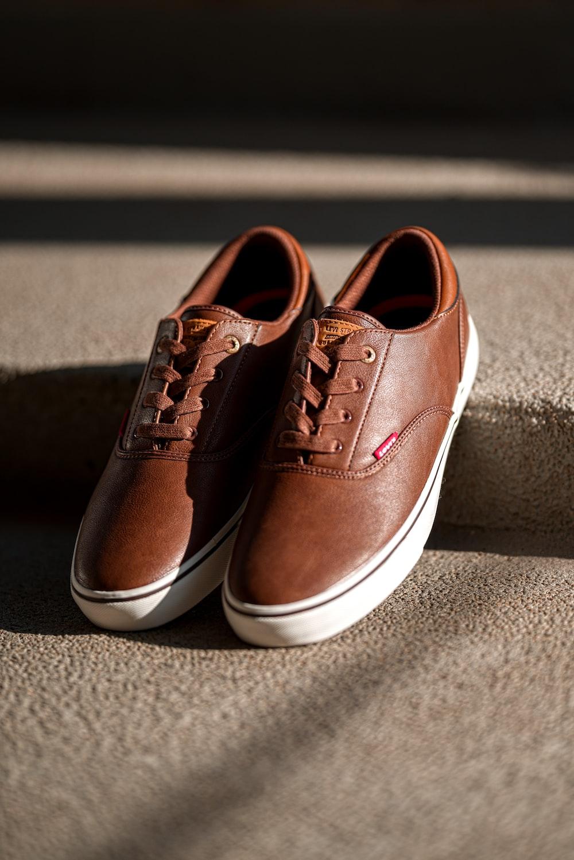 pair of brown low-top sneakers