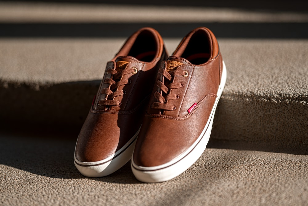 pair of brown and white low-top sneakers screenshot
