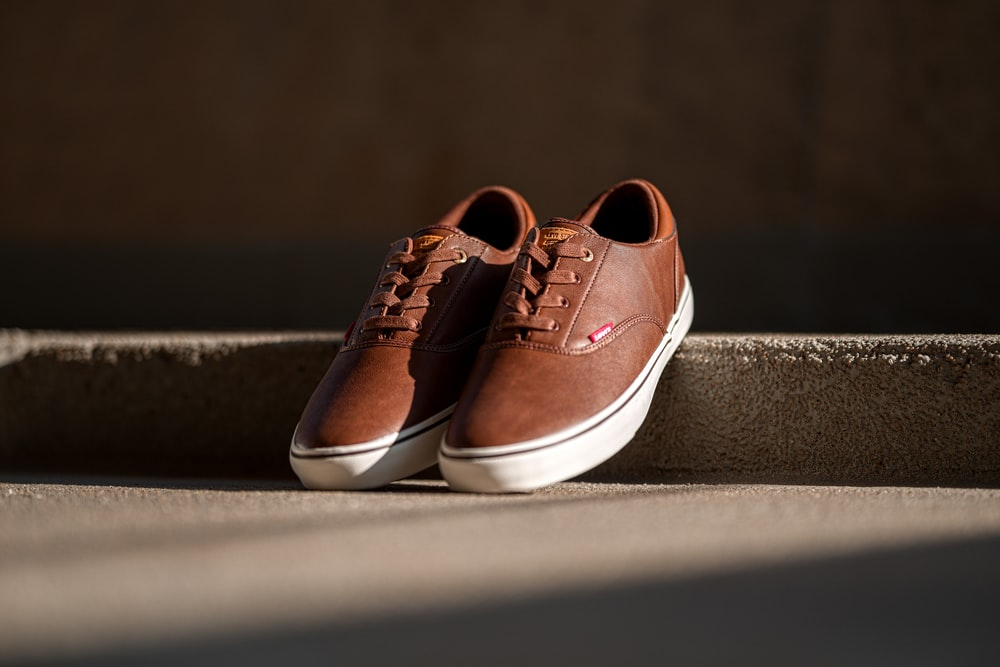 pair of brown Levi's leather low-top lace-up sneakers