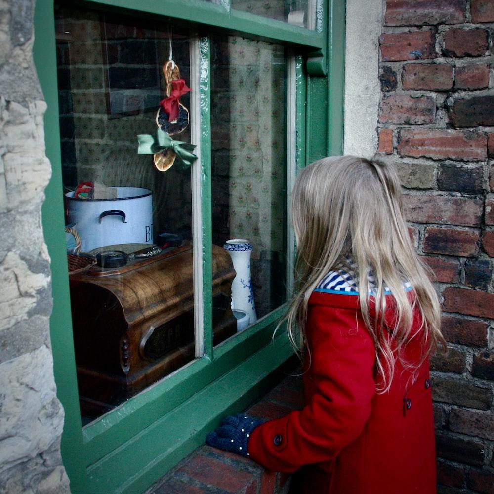 girl near glass window