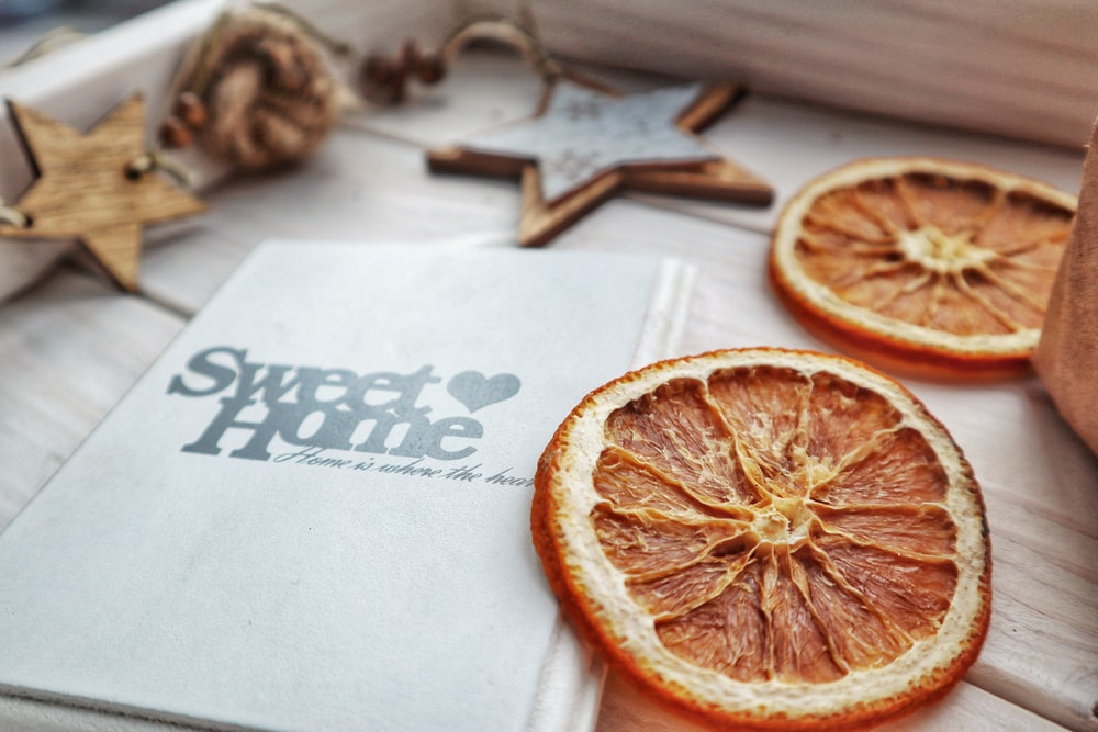 dried oranges beside a greeting card
