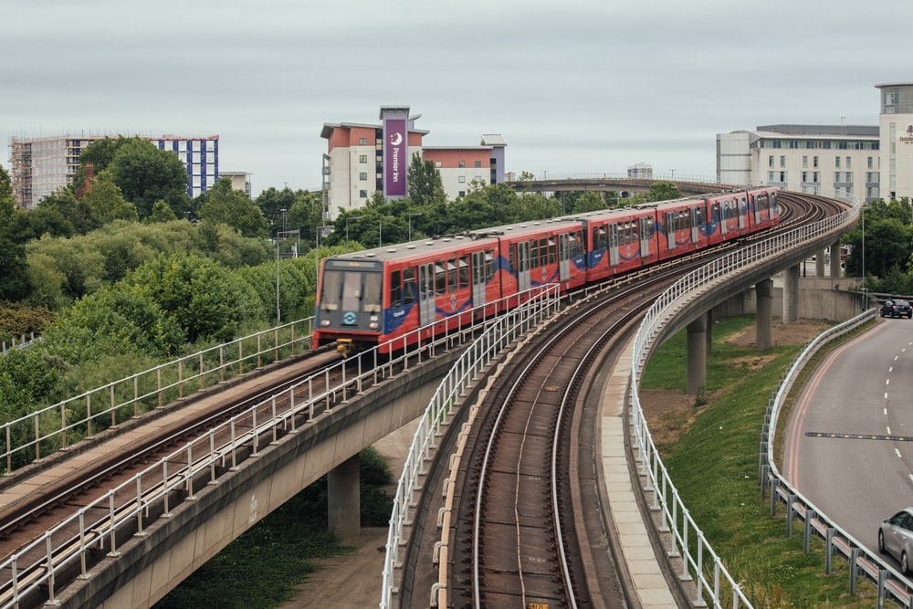 red and blue train in the city