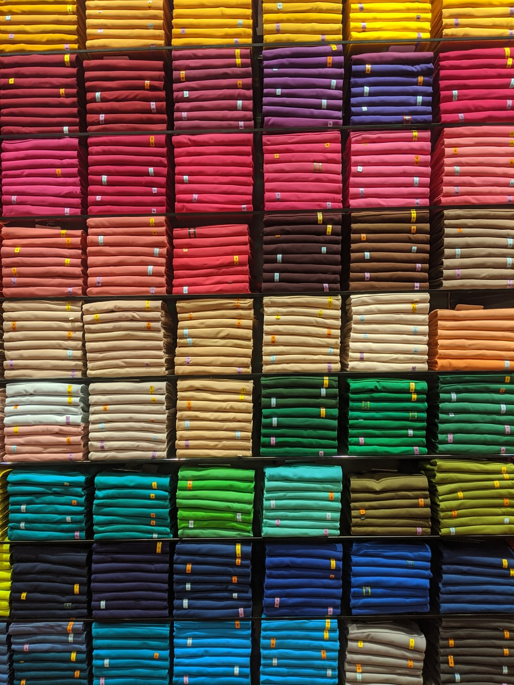 multiple cube storage of assorted-color textiles