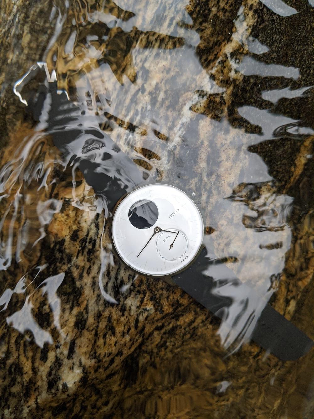 round gray chronograph watch