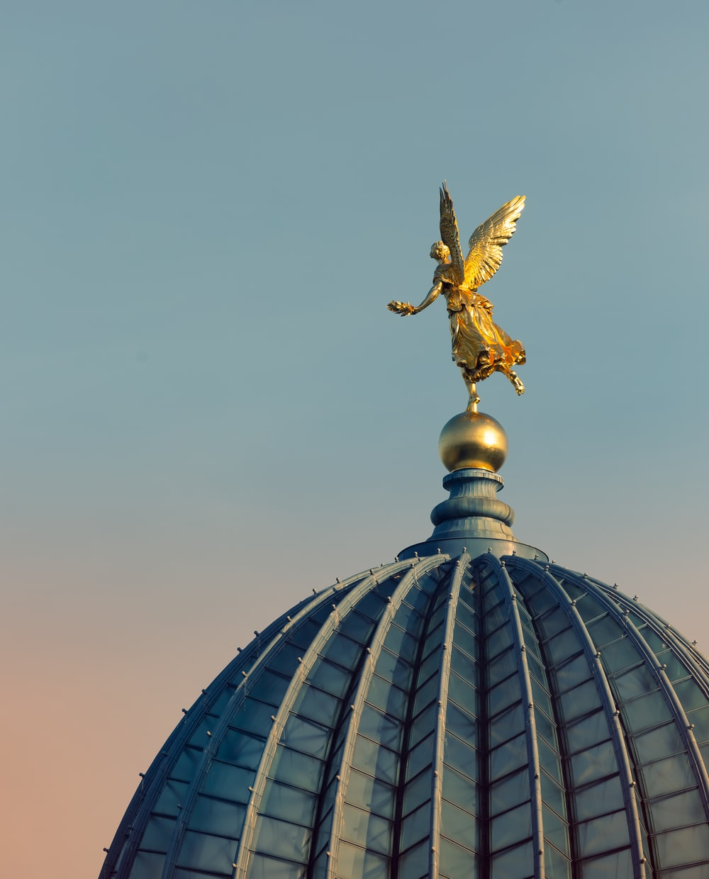angle statue on roof