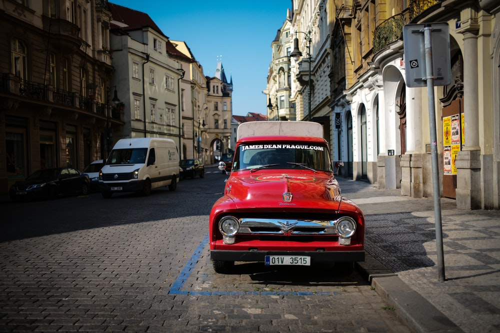 parked classic red vehicle