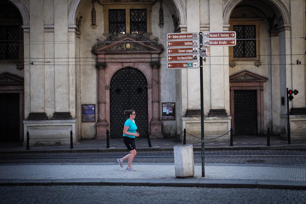 woman jogging beside road