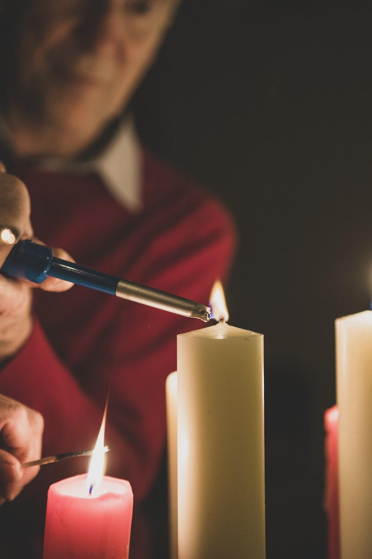 man lighting candles