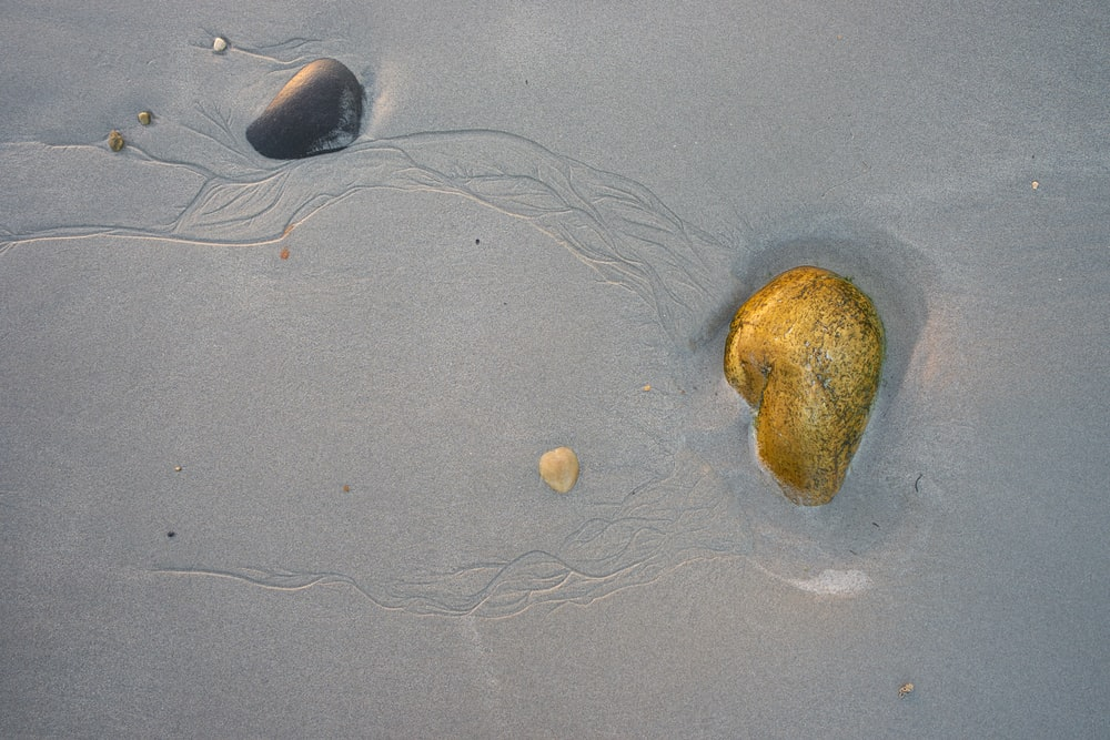 brown stone on shore
