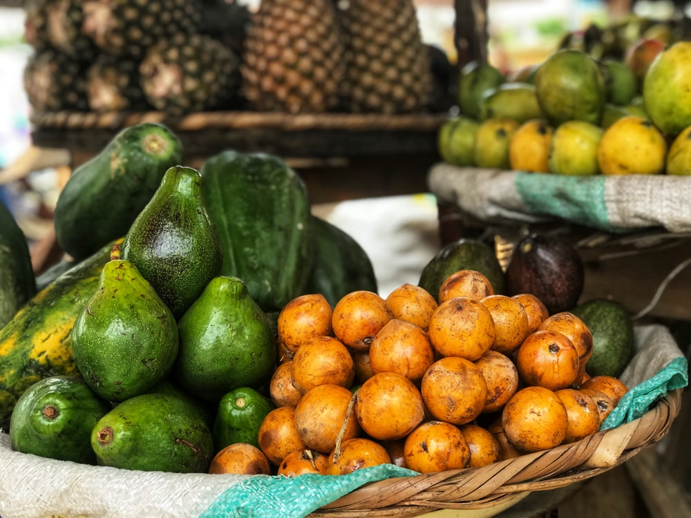 selective focus photography of displayed fruits