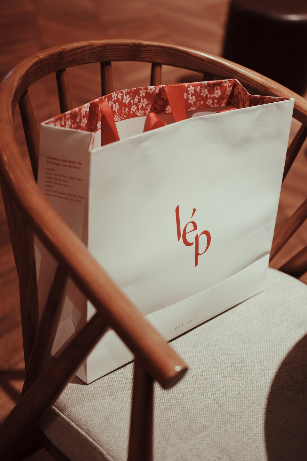 white paper bag on chair