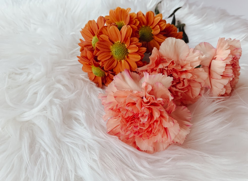 pink and orange flowers on white fur apparel