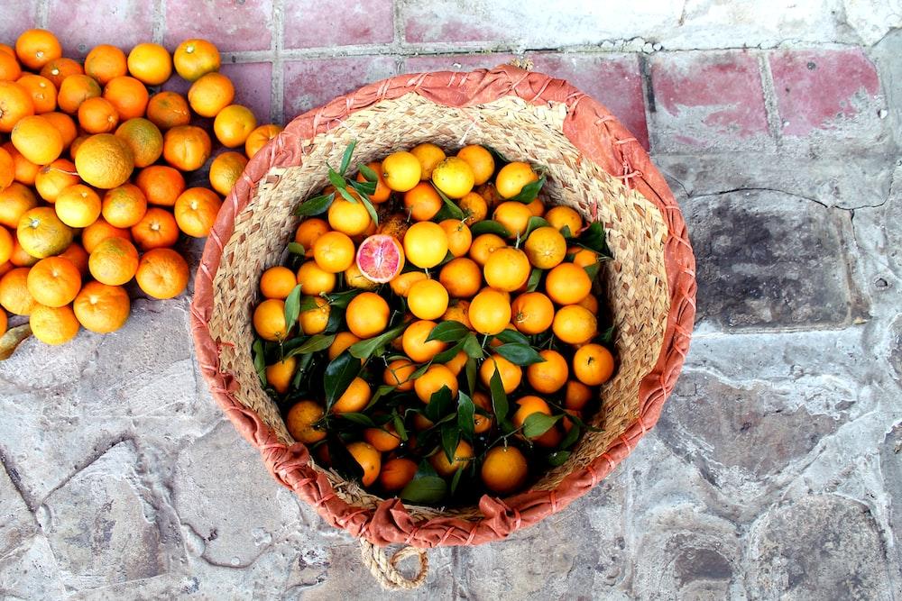 basket of orange fruits