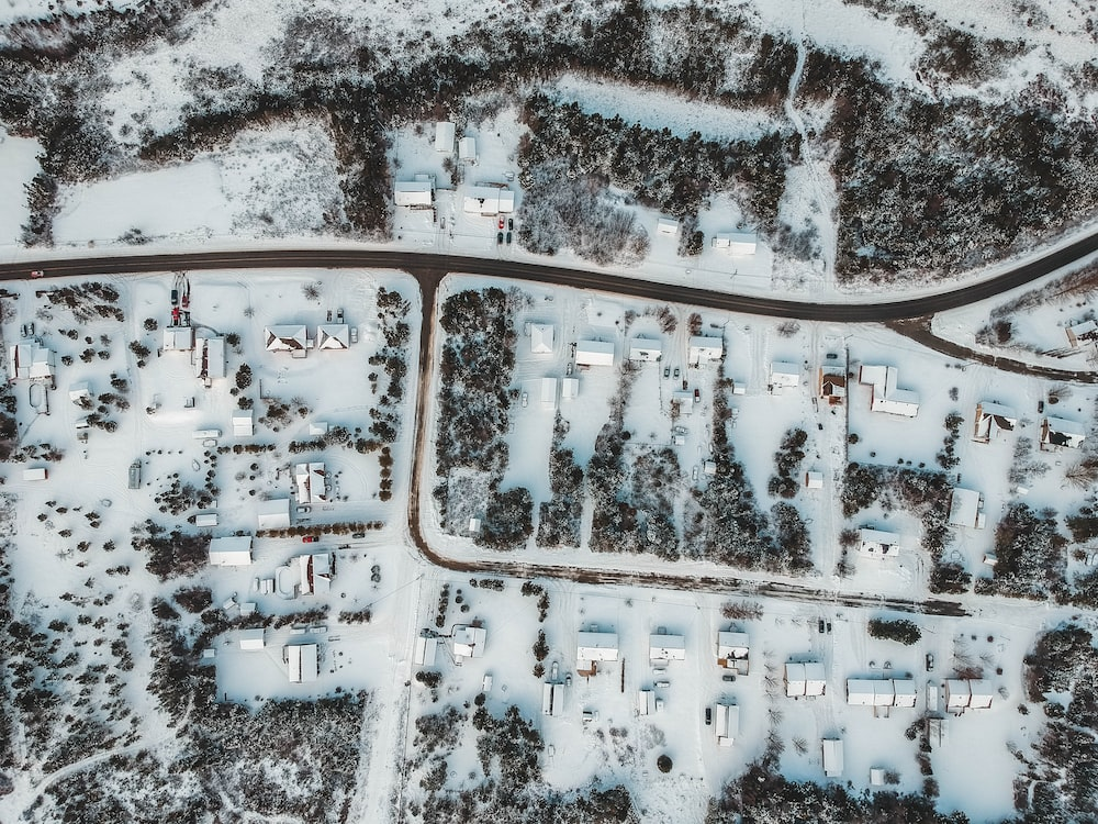 aerial photography of snow covered houses